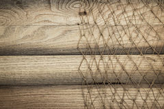 Wooden background texture and fishing net Stock Images