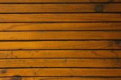 Wooden background texture. Water drops on wooden garden. Cool nature background. Orange brown desk Stock Image