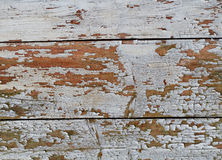Wooden Background Texture with Weathering White Coating. Detail of exfoliating wooden slats originally coated with white colour stock photo