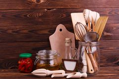 Many different kitchen utensils made of wood and different products. stock photo