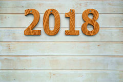Wooden 2018 background. Three-dimensional rendering of wooden 2018 on the wooden background, represents the new year 2018, 3D illustration Royalty Free Stock Images