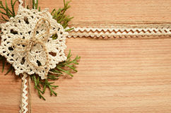 Background and crochet lace and thuja branches Stock Photo
