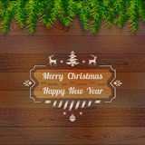 Wooden background with top pine branches Stock Photos