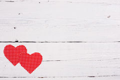 Wooden background with two red hearts Royalty Free Stock Images