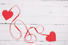 Wooden background with two red hearts Royalty Free Stock Photo