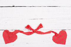 Wooden background with two red hearts Stock Images