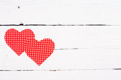 Wooden background with two red hearts Royalty Free Stock Image