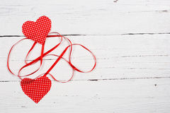 Wooden background with two red hearts Royalty Free Stock Photos