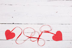 Wooden background with two red hearts Stock Image