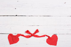 Wooden background with two red hearts Royalty Free Stock Photography