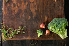 Wooden background with vegetables Stock Images