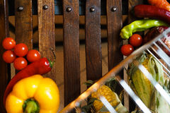Wooden background with vegetables stock photos