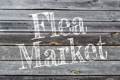 Wooden background with flea market. Wooden background with white flea market stock photo