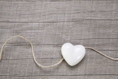 Wooden background with a white heart. Stock Image