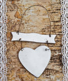 Wooden background with white lace. Wooden birch background with white lace border and blank white heart royalty free stock photos