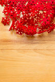 Wooden background, white and red snowflakes. Royalty Free Stock Photos