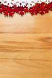 Wooden background, white and red snowflakes. Stock Photography