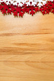 Wooden background, white and red snowflakes. Royalty Free Stock Photography