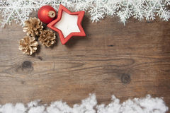 Wooden background with winter snow  and Christmas Decorations on Stock Photo