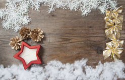 Wooden background with winter snow  and Christmas Decorations on Stock Image