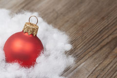 Wooden background with winter snow  and Christmas Decorations on Royalty Free Stock Photography