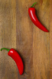 Wooden Background With Red Hot Chili Peppers Royalty Free Stock Photography