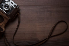 Wooden Background With Retro Still Camera Stock Image
