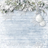 Wooden Background With Snowy Branches And Christmas Decorations Royalty Free Stock Photography