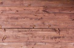 Wooden background,wooden wall painted with wood stain. Wooden background, wood texture,old wooden rustic fence royalty free stock image