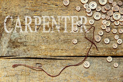 Wooden background with the word carpenter Stock Photography