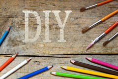Wooden background with the word diy Stock Images