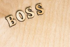 On a wooden background word, the label boss of wooden letters stock photo