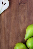 Wooden backgroung  with green pears Royalty Free Stock Photos
