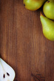 Wooden backgroung  with green pears. Vignette Stock Photos