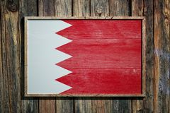 Wooden Bahrain flag. 3d rendering of Bahrain flag on a wooden frame over a planks wall Royalty Free Stock Photography