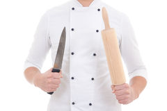 Wooden baking rolling pin and knife in chef hands isolated on wh Stock Photography