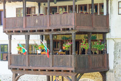 Wooden balconies over the entrance to the courtyard Troyan Monastery in Bulgaria Royalty Free Stock Images