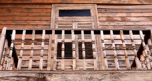 Wooden balcony and closed wooden shutters Stock Photography
