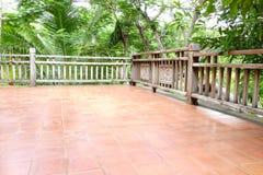 Wooden balcony beside the garden Royalty Free Stock Photo