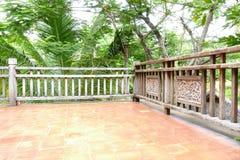 Wooden balcony beside the garden Stock Photo