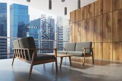 Wooden balcony, gray armchairs, city. Side Stock Photo