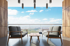 Wooden balcony, gray armchairs. Close up Stock Photography