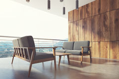 Wooden balcony, gray armchairs, mountain. Side Royalty Free Stock Photo