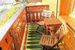 Balcony. Wooden balcony of mountain house with table and two chairs Stock Photography
