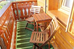 Balcony. Wooden balcony of mountain house with table and two chairs Royalty Free Stock Photo
