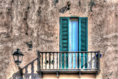 Wooden balcony in a rustic wall Stock Photos
