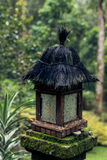 Wooden balinese lamp outdoors in the jungle rainforest of Bali island, Indonesia. Tropical background. Vintage asian Royalty Free Stock Photography