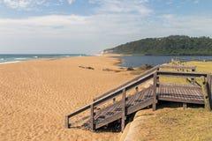 Wooden Balkway onto beach Against Coastal Seascape Royalty Free Stock Photo