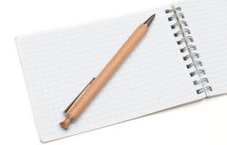 Wooden ball pen and a notebook Stock Photos