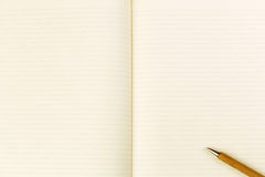 Wooden ballpoint pen on open notebook Royalty Free Stock Image